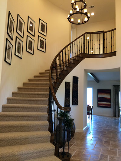 Tuscan iron on curved railing