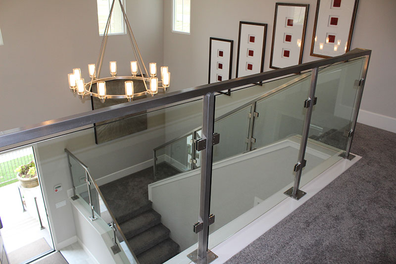 all stainless steel system with square top rail and clear tempered glass panels